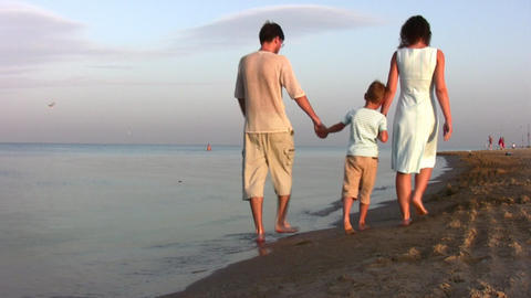 walking family with boy on beach Stock Video Footage
