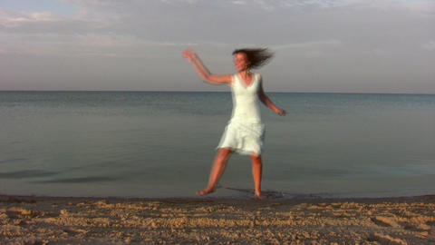 dancing woman on beach Footage