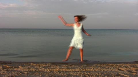 dancing woman on beach Stock Video Footage