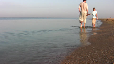 walking father with son on beach Stock Video Footage