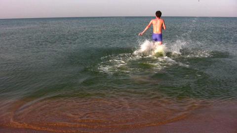 behind man run to swim Stock Video Footage