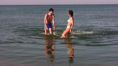 couple splashing water Stock Video Footage