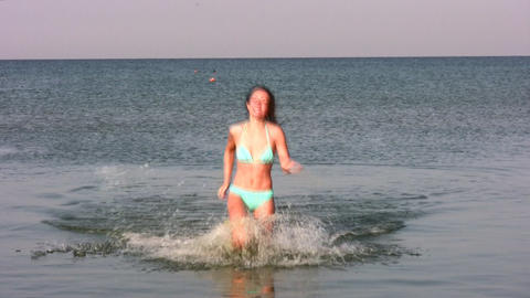woman running in water Stock Video Footage