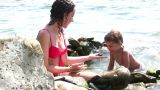 Mother With Girl On Stone Beach stock footage