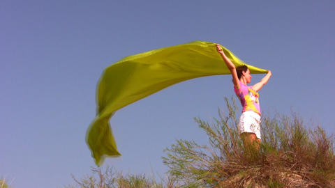 woman with fabric on sky Stock Video Footage