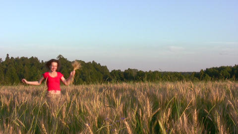 woman running in wheat field Stock Video Footage