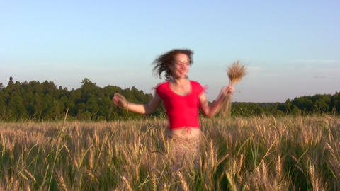 woman running in wheat field Stock Video Footage