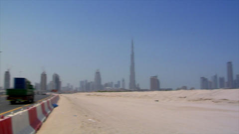 Dubai skyline pan burj emirates traffic Footage