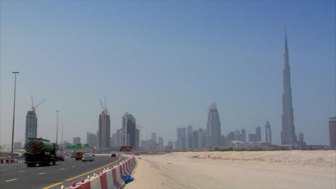 highway traffic at dubai skyline burj Stock Video Footage