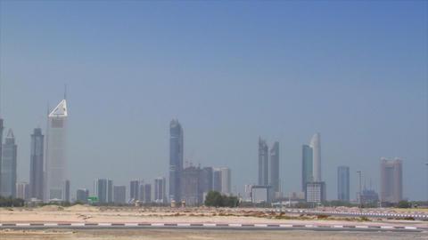 small car cross Dubai skyline pan burj emirates Stock Video Footage