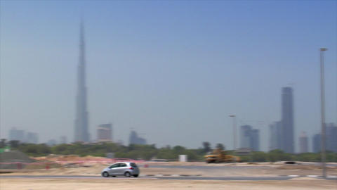 small car cross Dubai skyline pan burj emirates Footage
