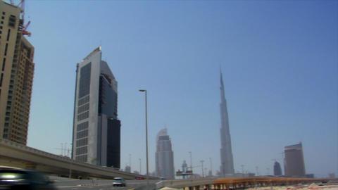 wideangle pan dubai skyline burj traffic Footage