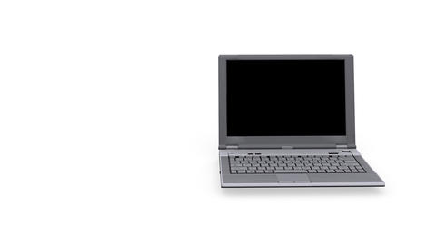 Laptop spinning on white background - Loopable - Technology Stock Video Footage