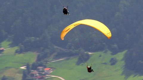 two 2 paraglider close together Stock Video Footage