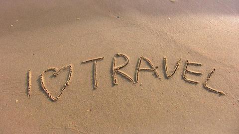 I love travel word on beach Stock Video Footage