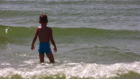 boy play with waves Stock Video Footage