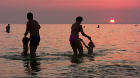 silhouette family of four on sunset sea Stock Video Footage