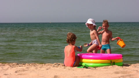 group children play on beach Stock Video Footage