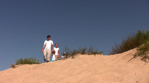 family of four on sea-bank Stock Video Footage