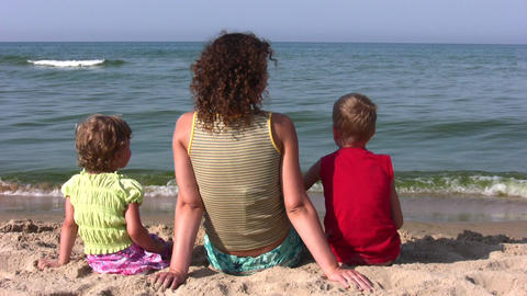 behind mother with children sit on beach Stock Video Footage