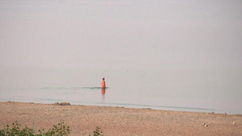 alone senior swim on beach Stock Video Footage