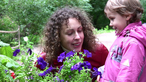 mother with girl and flowers Stock Video Footage