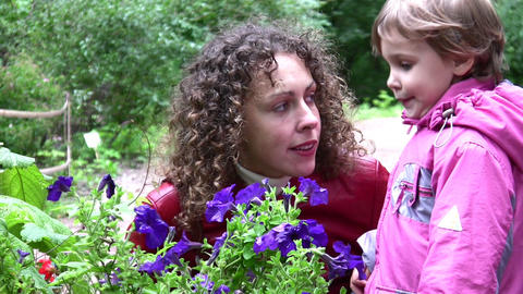 mother with girl and flowers Footage