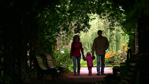 family silhouette in plant tunnel Stock Video Footage