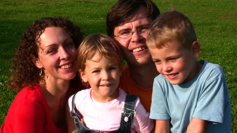 family of four faces Stock Video Footage