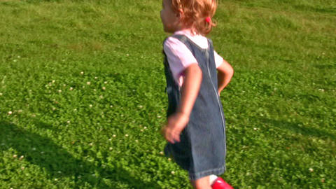 girl running to embrace mother Stock Video Footage