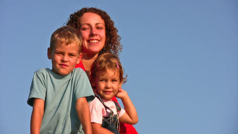 mother with children faces on sky Stock Video Footage
