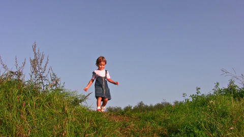 little girl walking on meadow alone Footage