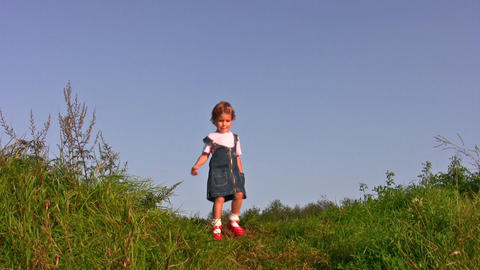 little girl walking on meadow alone Stock Video Footage