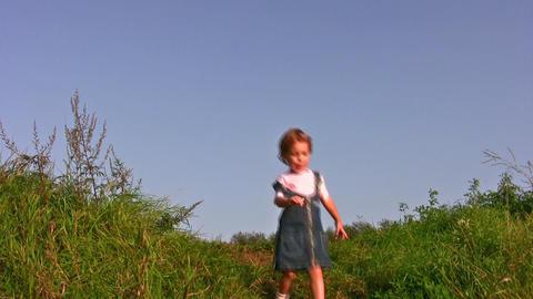 little girl walking on meadow alone Stock Video Footage