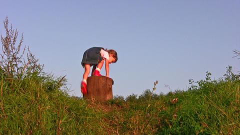 little girl climb on stump Stock Video Footage