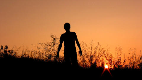 walking man silhouette on sunset sky alone Stock Video Footage