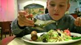 Boy With Sauce, Bread, Salad stock footage