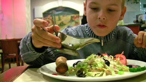 boy with sauce, bread, salad Footage