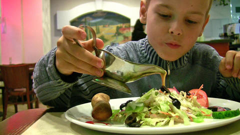 boy with sauce, bread, salad Stock Video Footage