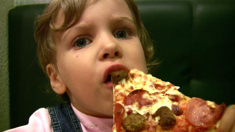 little girl eat pizza Footage