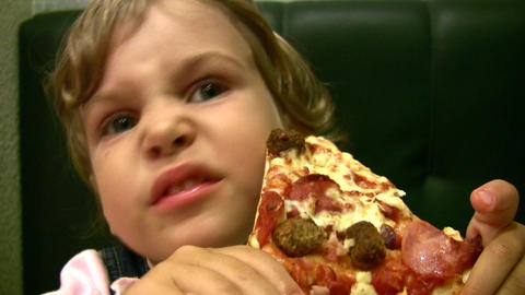 little girl eat pizza Stock Video Footage