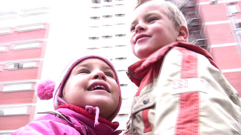boy with little girl on carousel Stock Video Footage