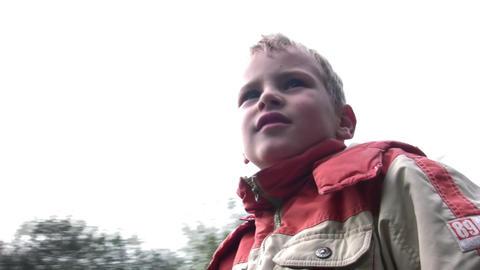 boy on carousel Stock Video Footage