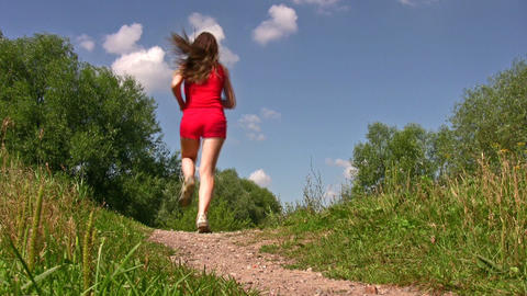 behind sport woman running in park Stock Video Footage