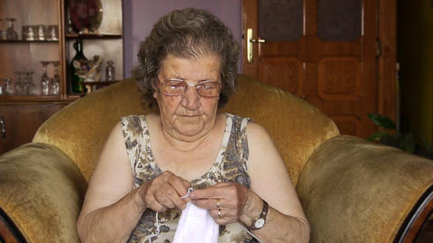 Old retired woman knitting in home Stock Video Footage