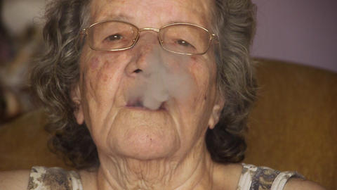 Old retired woman smoking cigarette Stock Video Footage