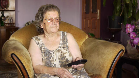 Old Retired Woman Watching Television stock footage