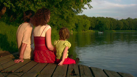 Family with girl on pond Stock Video Footage