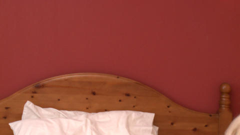 Delightful woman on phone lying down on bed Stock Video Footage