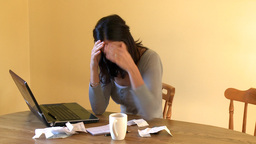 Weary woman doing her accounts Stock Video Footage